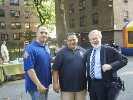 With 10th Precinct Community Affairs officers at the Night Out Against Crime event at Fulton Houses in Chelsea on August 5, 2014.