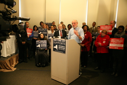 A supporter of the New York Health Act speaking at the press conference held before the Assembly Health Committee's Manhattan hearing on the bill.