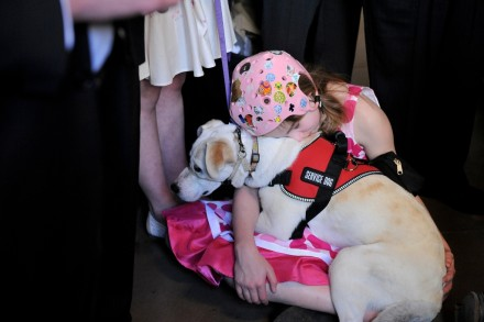 McKenzie and her service dog (credit: Assembly Photography)